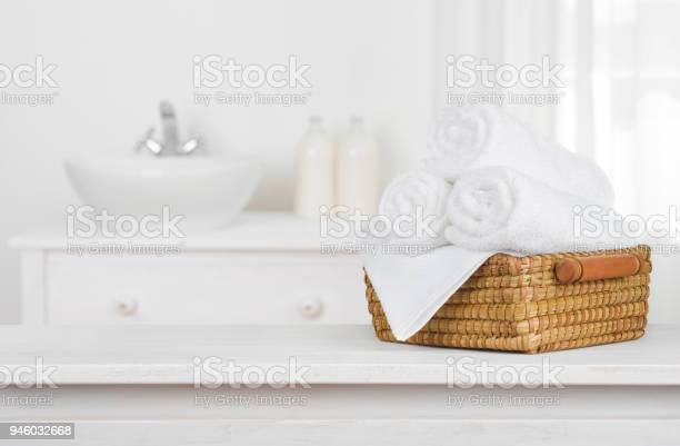 Towels basket on wooden table top with blurred bathroom interior picture id946032668?b=1&k=6&m=946032668&s=612x612&h=vtkrp9kfu1fnrle6i0xh7oxzc1o9dqxqmhhkhtwsfa8=