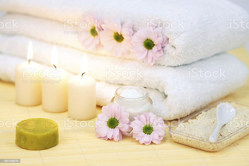Towels, candles, cream and flowers. Spa scene. royalty-free stock photo