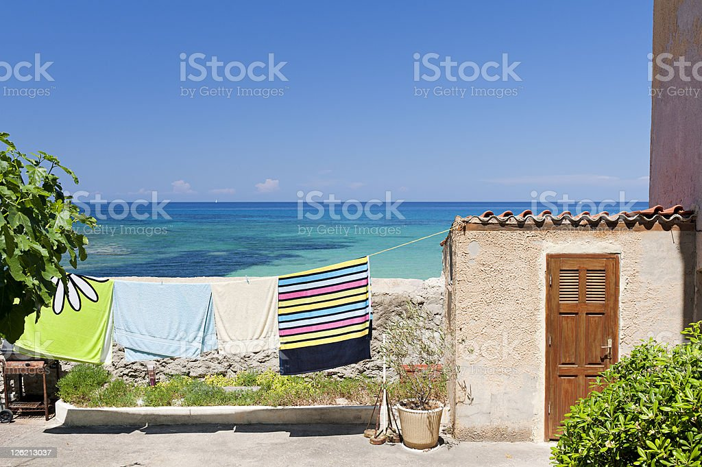 Towels on clothesline by the sea royalty-free stock photo