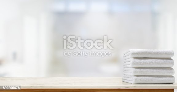 istock Towels on marble top table with copy space on blurred bathroom background. 829295678