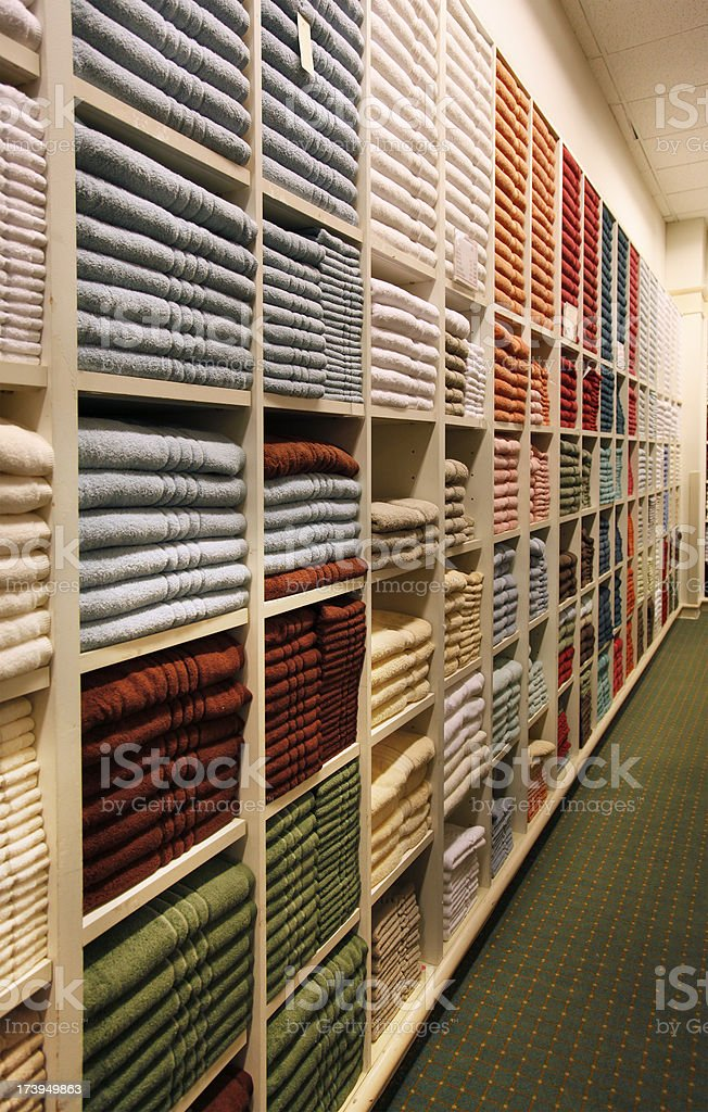 Towels on shelves in store.