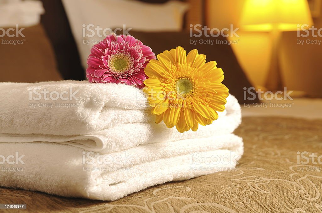 Towels on the bed stock photo