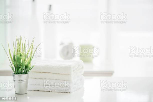 Towels on white table with copy space on blurred bathroom background picture id985388518?b=1&k=6&m=985388518&s=612x612&h=mjtoav3kpkdgkp7kaq4kjcji8tfbvdmr2q  esxv3zq=
