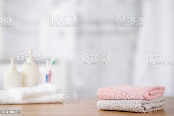 Towels on wooden table with copy space on blurred bathroom background picture id1169136027?b=1&k=6&m=1169136027&s=612x612&h=c5la2wxon8 ryxibommj9 s nuv 6r5ad9tljkinld4=