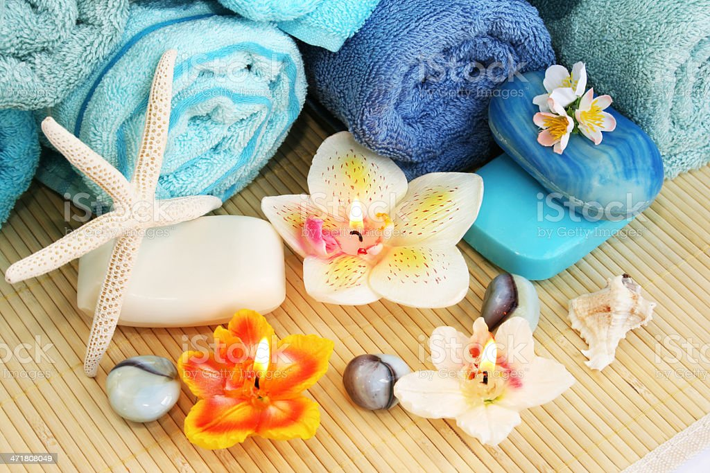 Towels, soaps, flowers, candles royalty-free stock photo