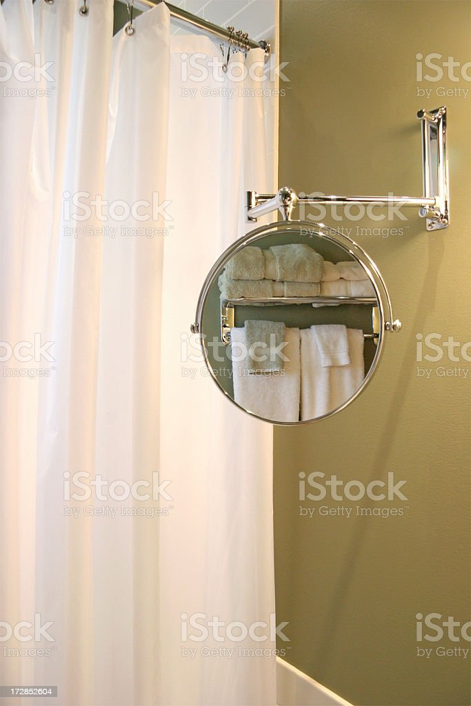 Towels Through A Bathroon Mirror. Vertical. stock photo