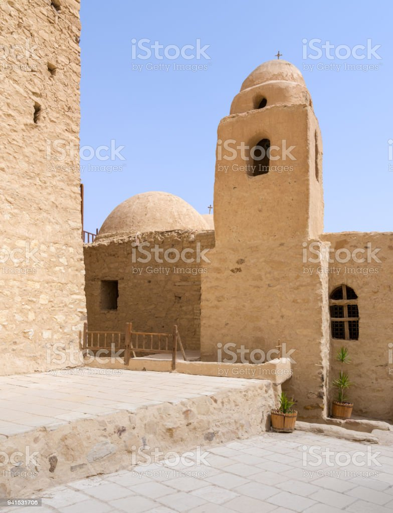 Tower and dome of the Church of St. Paul & St. Mercurius, Monastery of Saint Paul the Anchorite, dates to the fifth century AD and located in the Eastern Desert, near the Red Sea mountains, Egypt stock photo