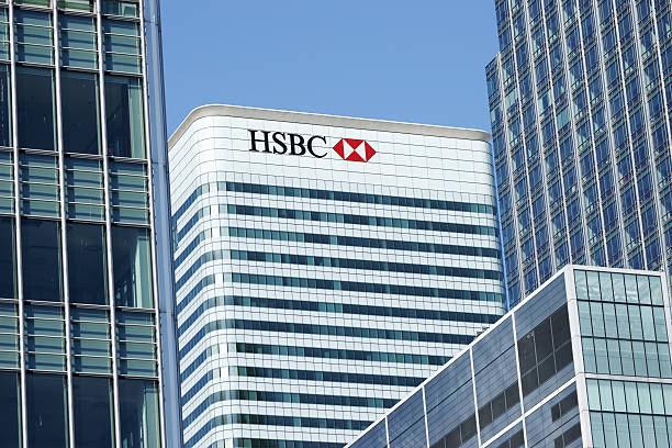 HSBC Tower at Canary Wharf in London Docklands London, United Kingdom - May 3, 2011: HSBC Tower at Canary Wharf in London Docklands. Global headquarters for the HSBC Group are in this 200 meter high tower with 45 floors. This is a third highest building in UK. View is partly obstructed with other high-rise buildings in Canary Wharf. hsbc stock pictures, royalty-free photos & images