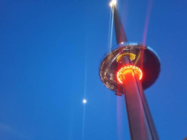 Tower at night with moon picture id1211110661?b=1&k=6&m=1211110661&s=612x612&w=0&h=zykceievuqtouaj5zjoq7e9owjki6ihhgkojqjhqzbw=