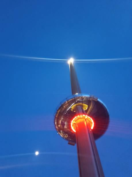 Tower at night with moon picture id1211258665?b=1&k=6&m=1211258665&s=612x612&w=0&h=f5koq eog5gtfemd9sb8vu6bwyb3codnbxvmzs6615w=