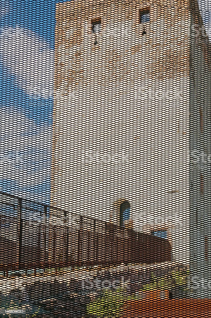 tower behind grating royalty-free stock photo