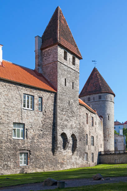 Tower behind Nuns & Golden Leg Tower in of the Wall of Tallinn stock photo