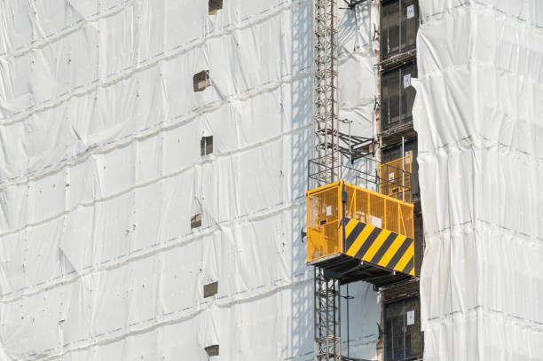 tower block construction elevator stock photo