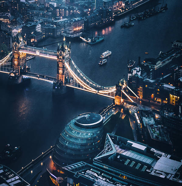 tower bridge aerial view at night tower bridge aerial view at night london england stock pictures, royalty-free photos & images