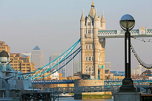 Tower Bridge and Canary Wharf View of the Tower Bridge and Canary Wharf during the day. bascule bridge stock pictures, royalty-free photos & images