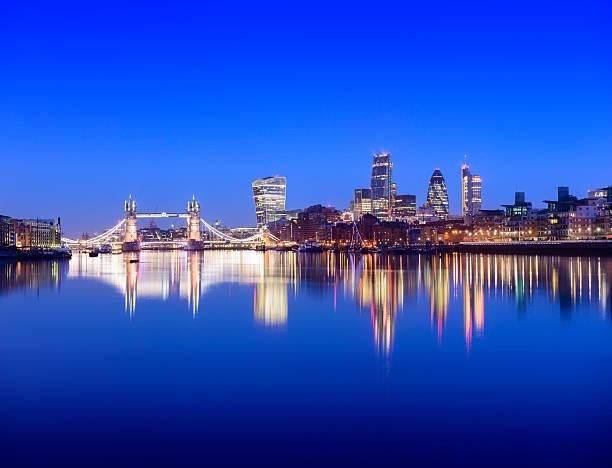 Tower Bridge and London City Skyline Reflection at Twilight stock photo