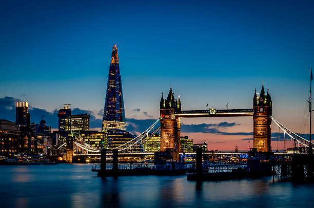 tower bridge and the sky london skyline at night - international landmark stock photos and pictures