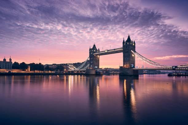 Tower Bridge at colorful sunrise stock photo