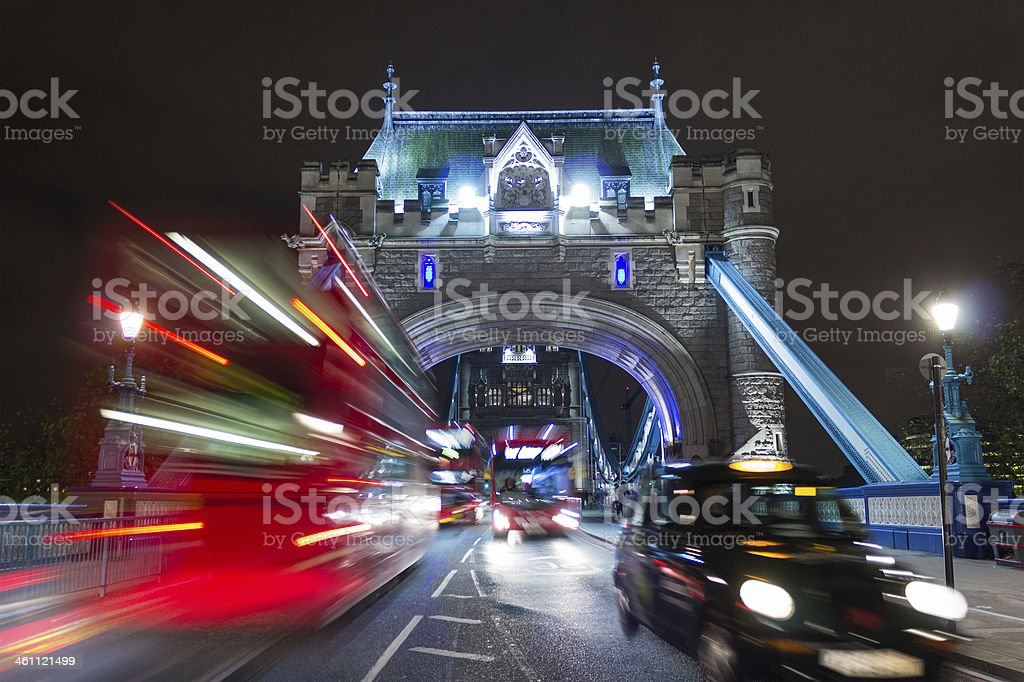 Tower Bridge Buses and a Taxi stock photo