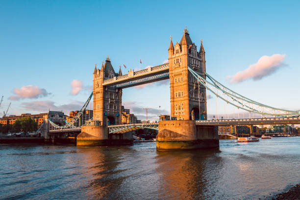 Tower Bridge in London at sunset Tower Bridge in London illuminated by the setting sun tower bridge stock pictures, royalty-free photos & images