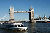 London, UK - June 25, 2018: Cityscape on Thames river with clippers ferry by London Eye, City Hall at Victoria Embankment in sunny summer