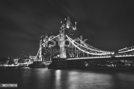 Tower Bridge, one of the London's most famous landmarks, is a bascule and suspension bridge on River Thames. It has two towers, in Victorian Gothic style, that are connected with two walkways that are constructed so they can resist horizontal forces from suspended parts of the bridge. 2018