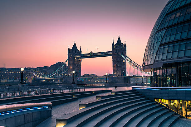 Tower Bridge in London, view from Southwark. Tower Bridge in London at sunrise , view from Southwark . tower bridge stock pictures, royalty-free photos & images