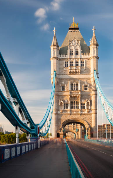 Tower Bridge in London with blue sky Long exposure shot of the Tower Bridge in London with blue sky. tower bridge stock pictures, royalty-free photos & images