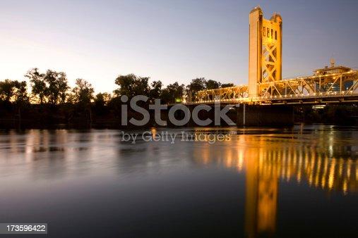 Golden tower bridge over Sacramento river.