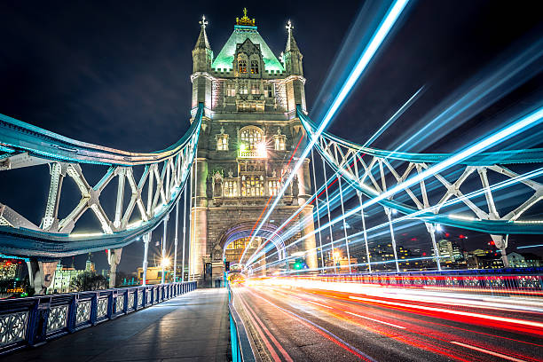 Tower Bridge Light Trail Colourful light trail created by the busy traffic on Tower Bridge, London. tower bridge stock pictures, royalty-free photos & images