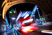 A long exposure image, complete with motion blur of a bus passing over Londons iconic Tower Bridge.
