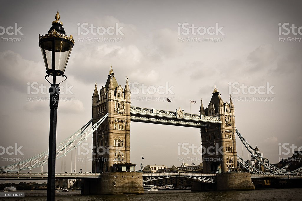 Tower bridge old view London's tower bridge with traditional lantern in front. Architecture Stock Photo