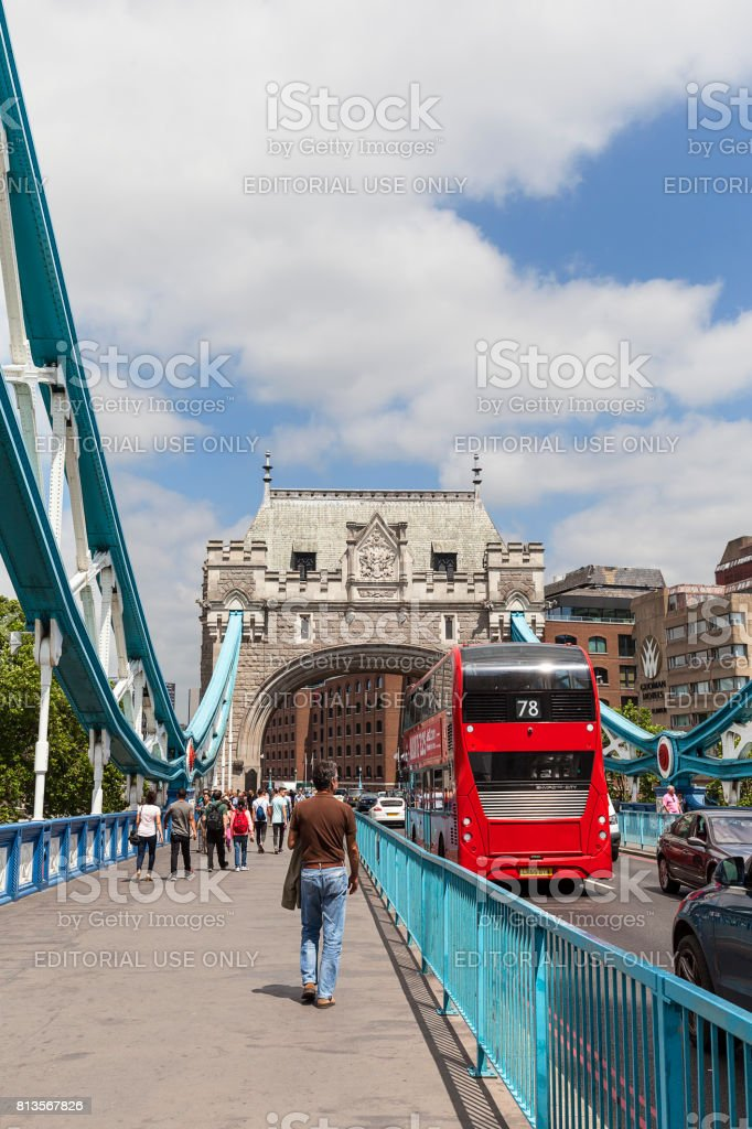 Tower Bridge on the River Thames and red double-decker bus, London, United Kingdom stock photo