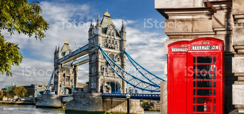 Tower Bridge with red phone booths in London, England, UK stock photo