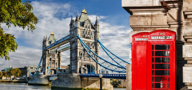 Tower Bridge with red phone booths in London, England, UK Tower Bridge with red phone booths in London, England, UK tower bridge stock pictures, royalty-free photos & images