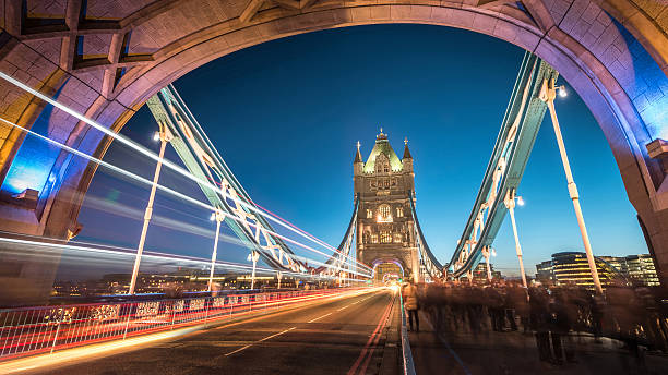Tower Bright shot through Tower Bridge at Twilight Tower Bright shot through Tower Bridge at Twilight tower bridge stock pictures, royalty-free photos & images
