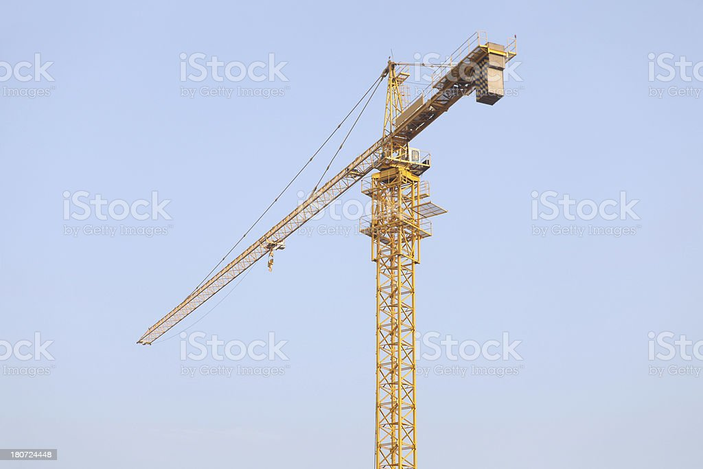 Tower crane against blue sky royalty-free stock photo