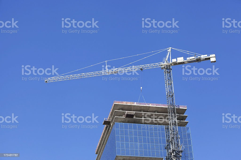 Tower Crane Building Glass Walled Skyscraper royalty-free stock photo