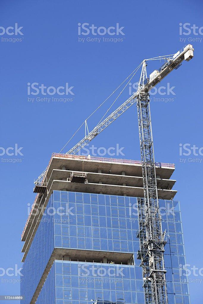 Tower Crane Building Glass Walled Skyscraper stock photo