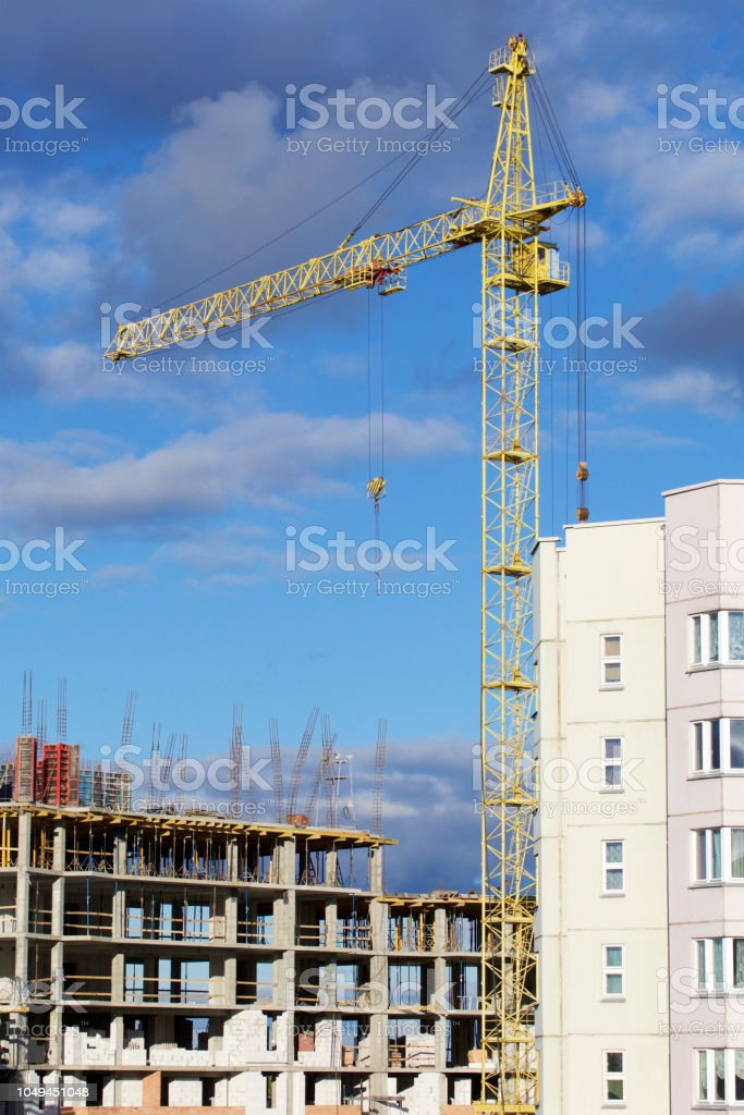 Tower Crane On The Construction Of A Building With A Frame