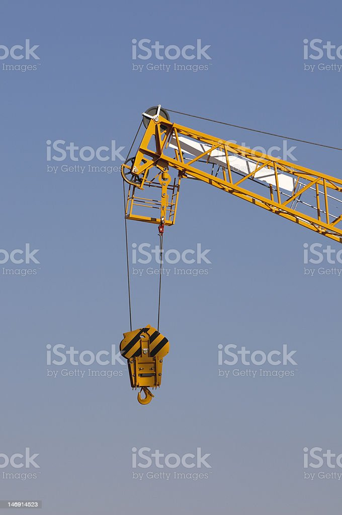 Tower crane with hoisting block and hook royalty-free stock photo