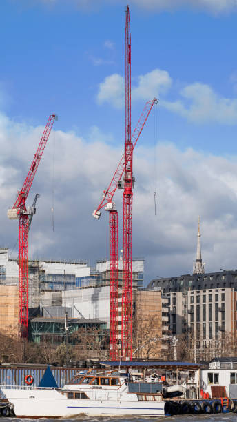 Tower cranes on the banks of the Thames stock photo
