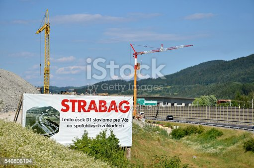 istock Tower cranes working on construction site of slovak D1 highway 546806194