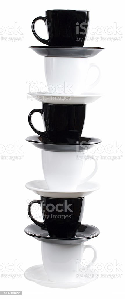 tower from six black & white coffee cups and saucers royalty-free stock photo