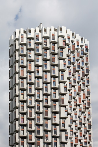 Grenoble, France - May 18, 2014: Emblematic tower in the city of Grenoble, green island district and built between 1963 and 1967 by architects Roger Anger and Pierre Puccinelli