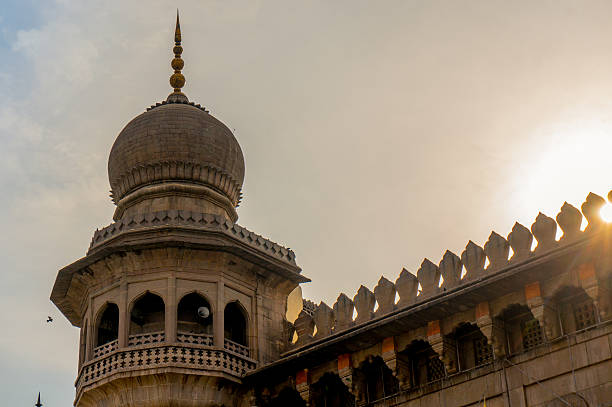 tower minar of a mosque in hyderabad Minar tower of a mosque during sunset against clouds. Shot in the old city of hyderabad char minar stock pictures, royalty-free photos & images