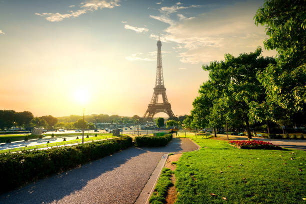 tower near park in paris - eiffel tower stock photos and pictures