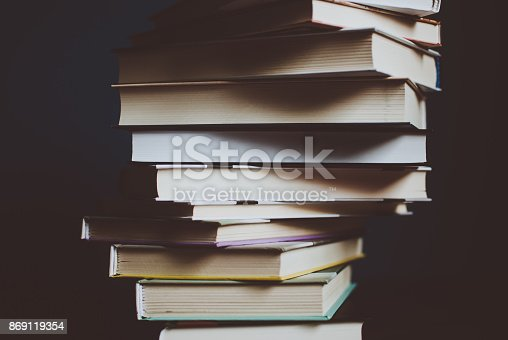 istock Tower of colorful books on the table. Closeup of pages. 869119354