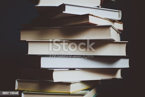 istock Tower of colorful books on the table. Closeup of pages. 869119546