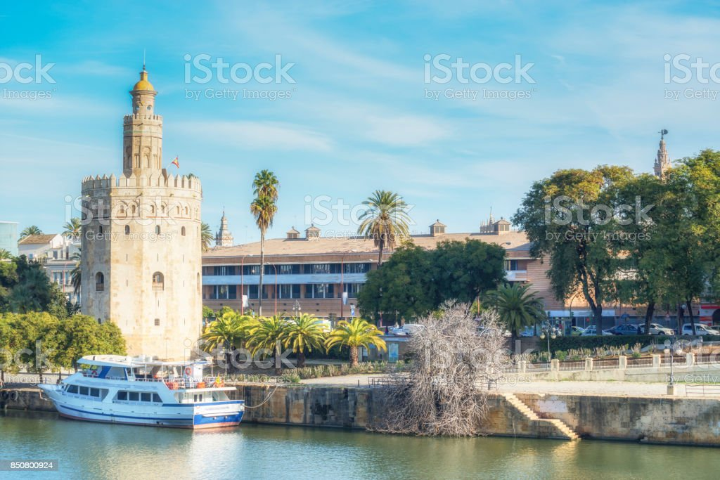 Tower of Gold and cruise ship on the Guadalquivir River in Seville, Spain (Tore del Oro) stock photo
